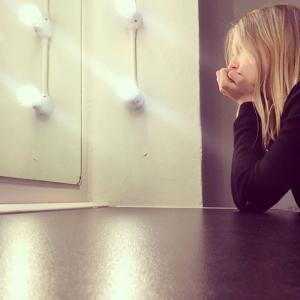 blond girl on a vanity mirror