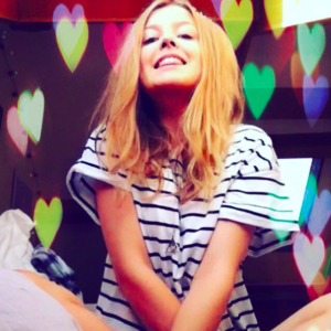 blond girl with hearts of color with a stripped tshirt