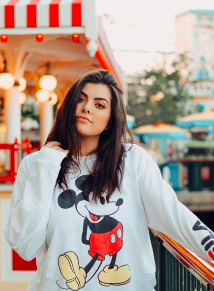 brunette girl with a mickey sweater
