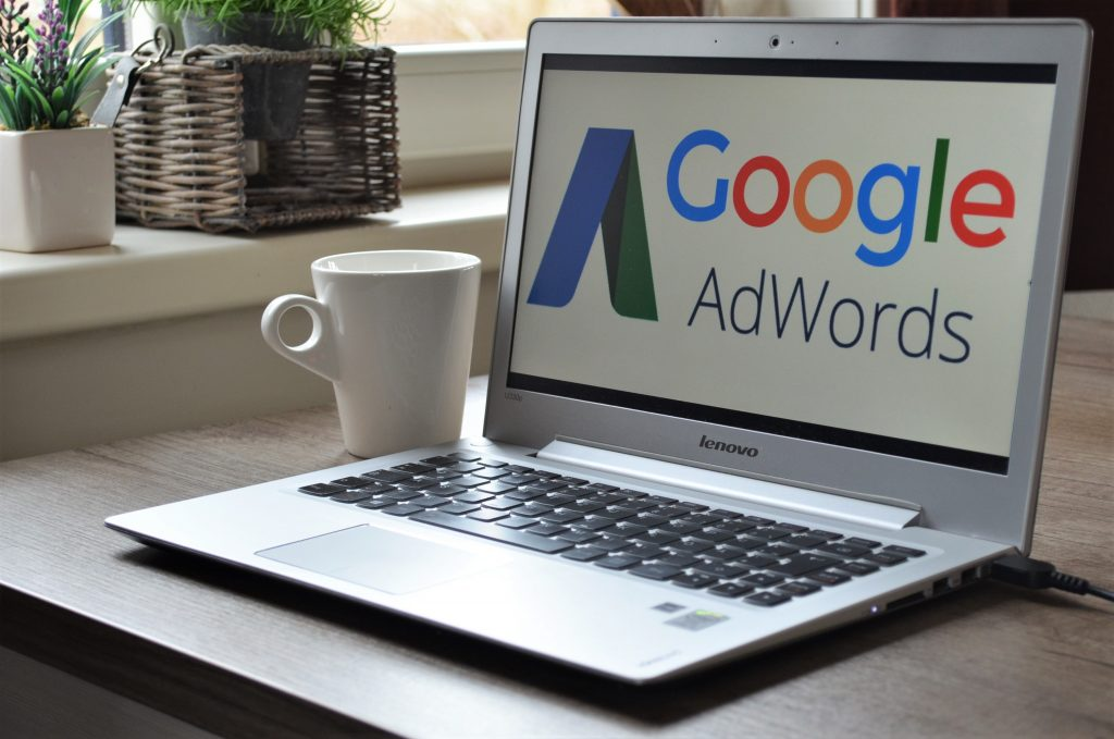 Google Adwords computer with coffee mug
